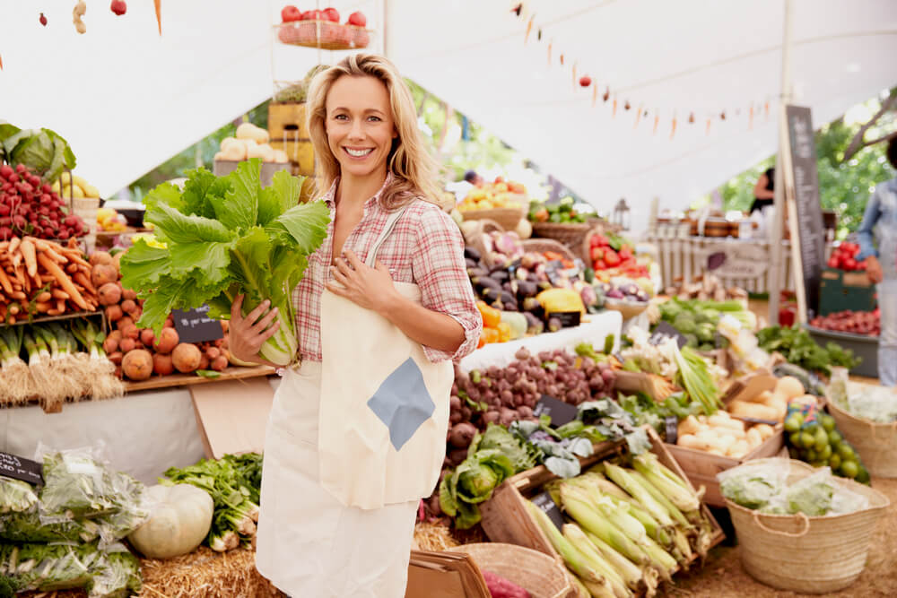 Smiling woman at farmers market