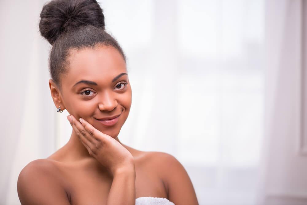 Smiling woman in bathroom